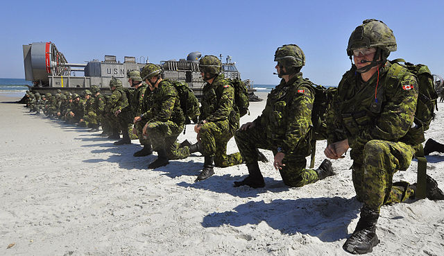 640px-US_Navy_090424-G-6464J-013_Canadian_soldiers_set_a_perimeter_position_after_disembarking_a_U.S._Navy_landing_craft_during_a_simulated_amphibious_landing.jpg